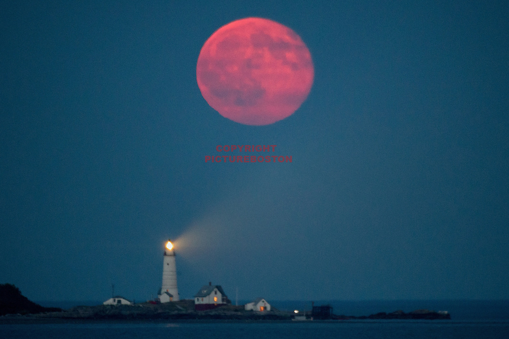July 20, 2016-Boston,MA Tonight's full moon rises over Boston Light.