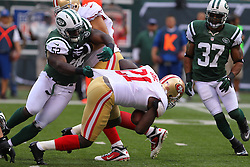 Sept 30, 2012; East Rutherford, NJ, USA; New York Jets inside linebacker David Harris (52) tackles San Francisco 49ers running back Frank Gore (21) during the first half at MetLIfe Stadium.
