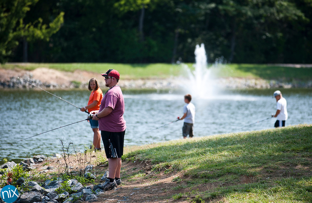 Discovery Day Camp head councilor David Madorin and his campers fish at Frank Liske Park in Concord Thursday morning. (photo by James Nix)