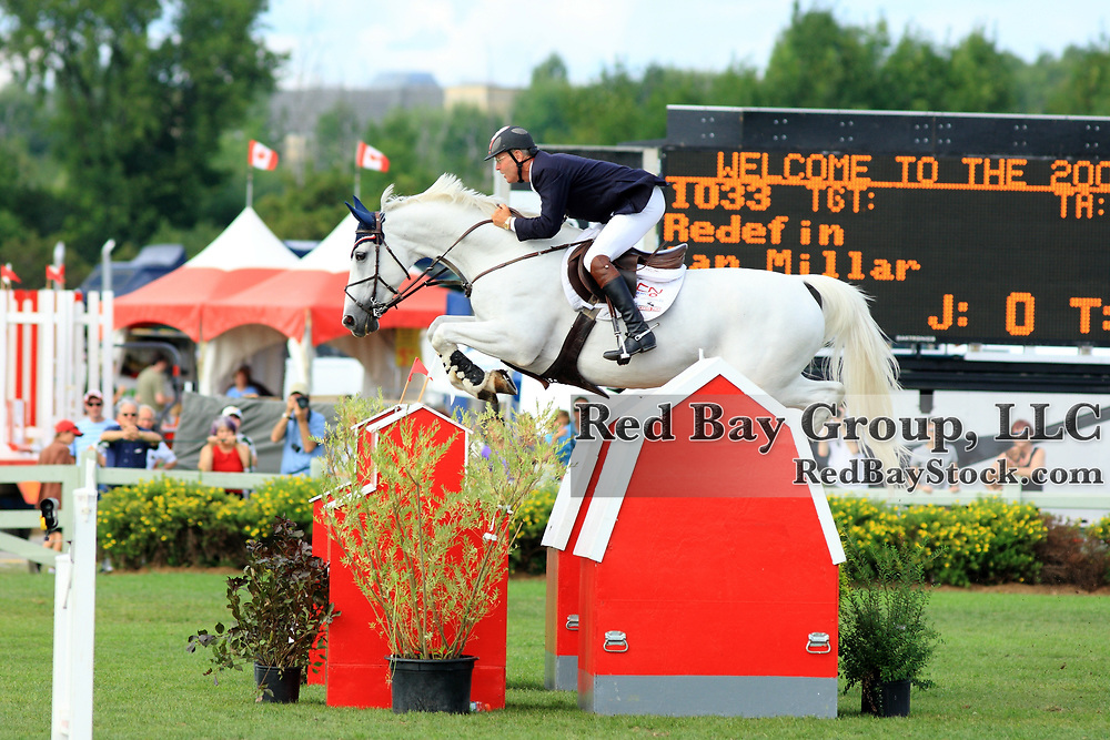 Ian Millar and Redefin in the Brookstreet Grand Prix CSI** at the 2009 National Capital Show Jumping Tournament in Ottawa, Ontario.