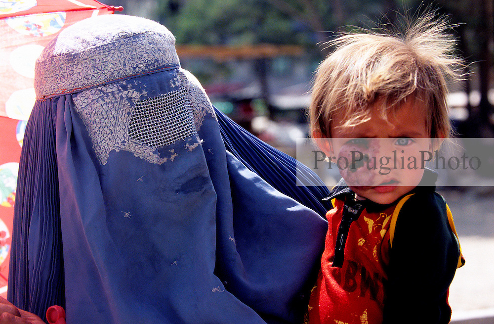 KABUL 03 August 2005.FIrst day, walking in the busy street of the City, I see Shabana and her Mother.