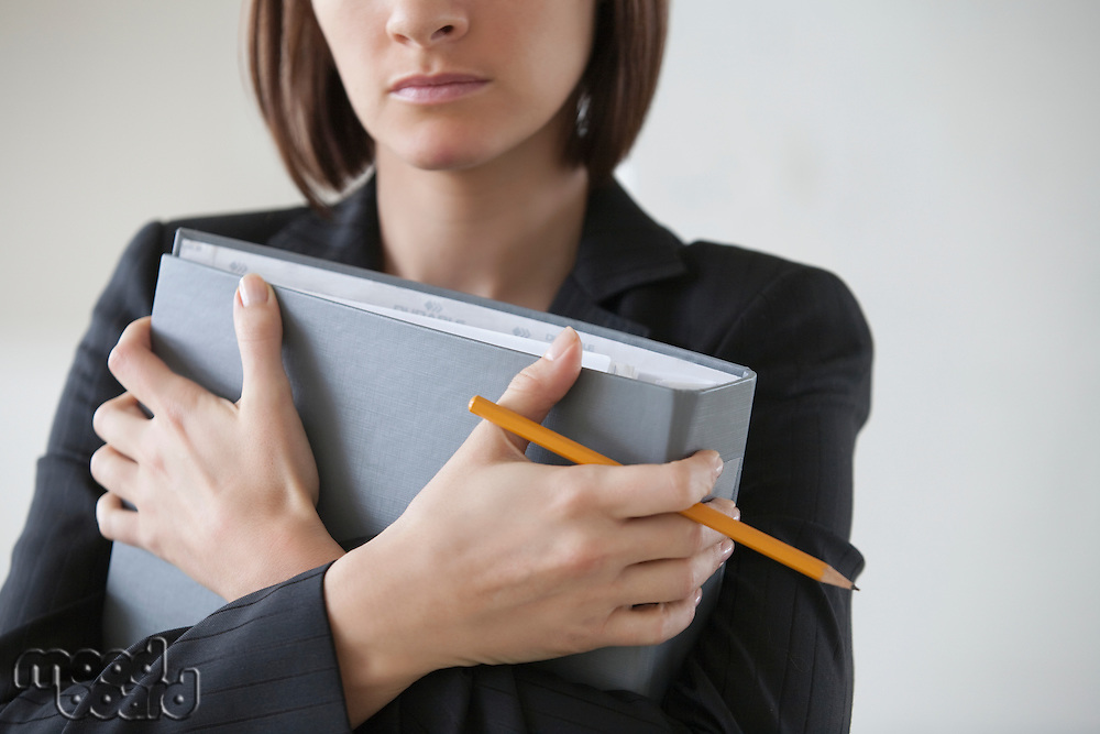 Business woman on holding file with crossed hands