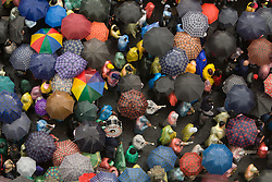 South America, Ecuador, Pinchincha Province, Quito.  Sea of umbrellas viewed from above; procession during Holy Week (Semana Santa) on Good Friday.
