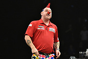 Peter Wright wearing a red nose for Comic Relief during the Betway Premier League Darts at the Manchester Arena, Manchester, United Kingdom on 23 March 2017. Photo by Mark Pollitt.