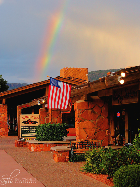 A rainbow glistens over a small plaza in downtown Sedona