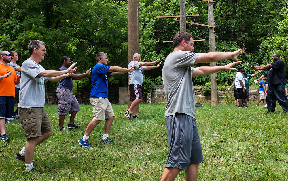 "Master's in Athletic Administration students participate in a ""Hog Call"" game during the outdoor challenge course at The Ridges on Friday, June 26, 2015. © Ohio University / Photo by Rob Hardin"