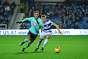 Derby County midfielder Tom Ince (10) chases down the ball from Queens Park Rangers defender Jake Bidwell (3) during the EFL Sky Bet Championship match between Queens Park Rangers and Derby County at Loftus Road, London, England on 14 December 2016. Photo by Jon Bromley.