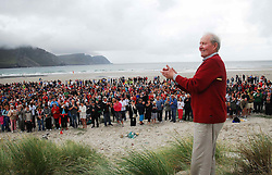 John 'Twin' McNamara salutes the crowd that gathered on Keel beach Achill on saturday for the world record attempt. The ensemble estimated to be around 1050 played the tune 'Fainne Geal an Lae' on Achill's longest beach and was part of the Scoil Acla celebrations that took place over the past week...Pic Conor McKeown