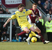 Photo: Ian Hebden.<br /> Northampton Town v Peterborough United. Coca Cola League 2. 31/12/2005.<br /> 05 Peterboroughs James Quinn evades Northamptons Luke Chambers.