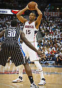 24 April 2011: Atlanta's Al Horford (15) is being defended by Orlando's Brandon Bass in Atlanta Hawks 88-85 victory over the Orlando Magic in Eastern Conference First Round Game 4 at Philips Arena in Atlanta, GA.