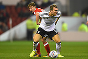 Fulham midfielder Kevin McDonald (6) battles with Nottingham Forest midfielder, on loan from Everton, Kieran Dowell (20) during the EFL Sky Bet Championship match between Nottingham Forest and Fulham at the City Ground, Nottingham, England on 26 September 2017. Photo by Jon Hobley.