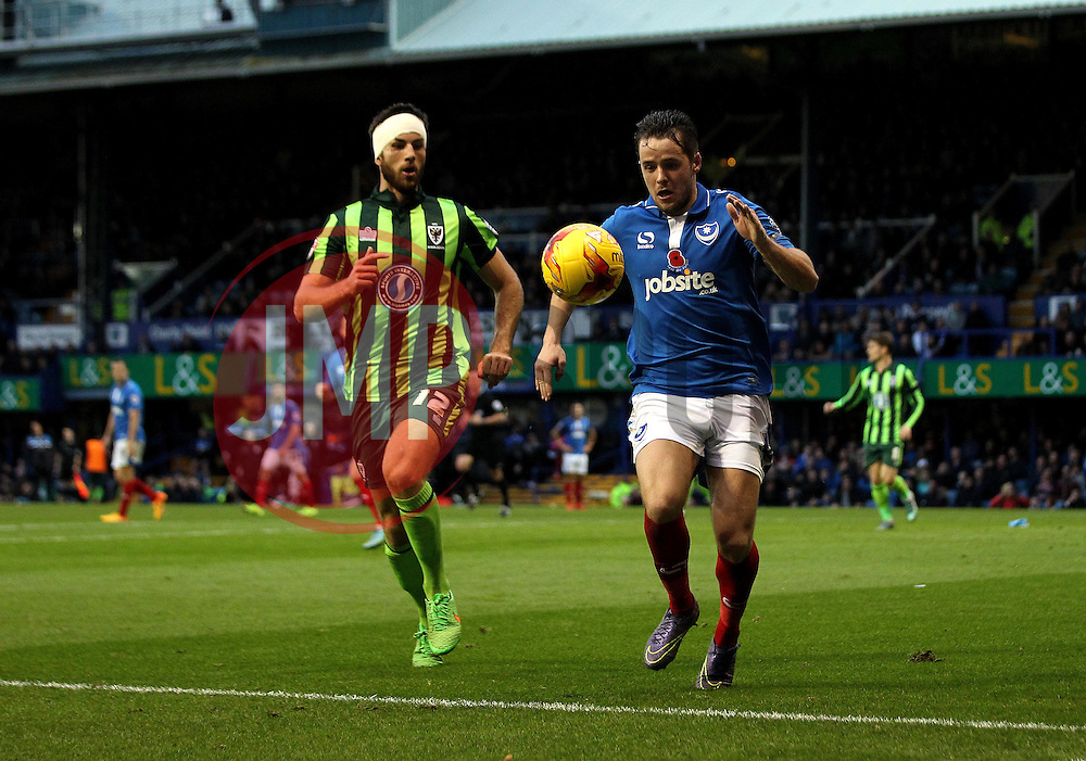Marc McNulty of Portsmouth is forced wide by Jonathan Meades of AFC Wimbledon - Mandatory byline: Robbie Stephenson/JMP - 07966 386802 - 15/11/2015 - Rugby - Fratton Park - Portsmouth, England - Portsmouth v AFC Wimbledon - Sky Bet League Two