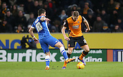 Hull City defender Michael Dawson (21) and Brighton striker, Tomer Hemed (10) during the Sky Bet Championship match between Hull City and Brighton and Hove Albion at the KC Stadium, Kingston upon Hull, England on 16 February 2016.
