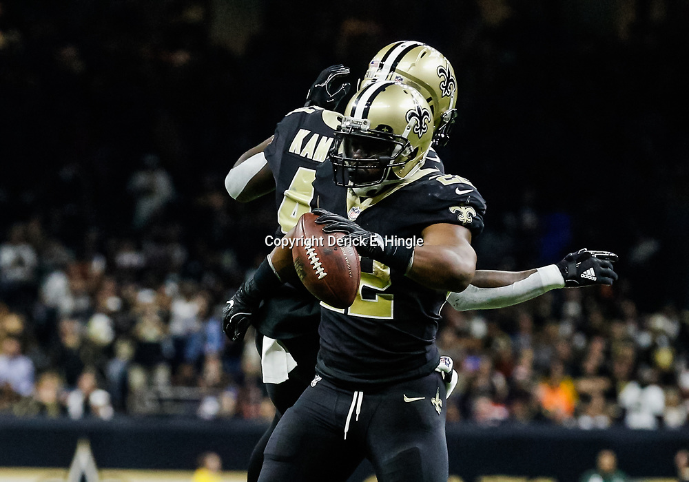 Oct 29, 2017; New Orleans, LA, USA; New Orleans Saints running back Mark Ingram (22) celebrates after a touchdown with running back Alvin Kamara (41) during the first half of a game against the Chicago Bears at the Mercedes-Benz Superdome. Mandatory Credit: Derick E. Hingle-USA TODAY Sports