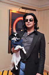 PRINCE MUBARAK AL KHALIFA with his dog Napoleon at The Dog's Trust Awards announcement held at George, 87-88 Mount Street, London on 27th March 2012.