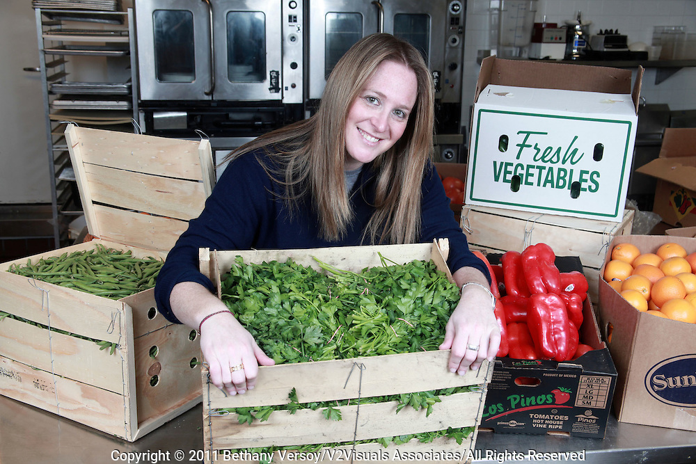 1-10-11-BOSTON. MA.Ashley Stanley, Lovin' Spoonfuls Founder and Executice Director shows some of the produce she collects from local area restaurants that she then distributes to shelters..