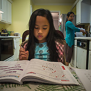 "Atlanta, Georgia/Burma Refugee/ Klaw Htoo, prepares dinner as her daughter Sophia does her homework, at their home in Atlanta. Klaw and her family were forced to flee Burma (also known as Myanmar) and they lived in an refugee camp in Thailand for nine years. Klaw arrived in the U.S. in 2007 alone with her oldest daughter Sophia (8), she was pregnant with Gloria (4). Her husband was not able to join her, and today he is still living in a camp in Thailand while he waits to be reunited with his family in the U.S. The IRC in Atlanta provided Klaw and her girls with a place to live and helped Klaw learn English, and find daycare so she could work. Eventually Klaw was hired as a case aide with the IRC in Atlanta. ?I liked to share my story with them and I interacted with the clients. I would give them details on how to live in the U.S.,? said Klaw. ""Life in America is tough but better than in my country because if I compare there is no way to have a good education in my country. Here there are lot of resources, for myself and my kids, we can get a good education. You have freedom and everything."" After two years of working for the IRC, Klaw went to work at Emory University and the DeKalb County Department of Health to do tuberculosis screenings and provide education to the public. ?It is such a big opportunity for me to work for them,? she said. Klaw became a U.S. citizen on January 28, 2013. /UNHCR/E.Hockstein/February 2013."