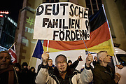 Frankfurt am Main | 02 Feb 2015<br /> <br /> Am Montag (02.02.2015) demonstrierten in Frankfurt an der Hauptwache etwa 60 PEGIDA-Anh&auml;nger mit teils extrem rassistischen Reden und Parolen z.B: gegen &quot;Islamisierung&quot;, an den Aktionen gegen die Rechtsextremisten nahmen mehrere tausend Menschen teil.<br /> Hier: PEGIDA-Demonstranten mit einem Transparent mit der Aufschrift &quot;Deutsche Familien f&ouml;rdern&quot;.<br /> <br /> &copy;peter-juelich.com<br /> <br /> [No Model Release | No Property Release]
