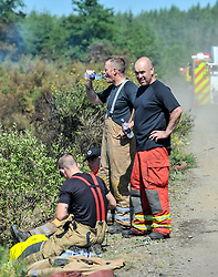 Firefighters battle a major brush fire on the outskirts of Fauldhouse, West Lothian. It has been categorised as a level 4 fire, with around 12 appliances and more than 60 firefighters on scene.<br /> <br /> © Dave Johnston / EEm