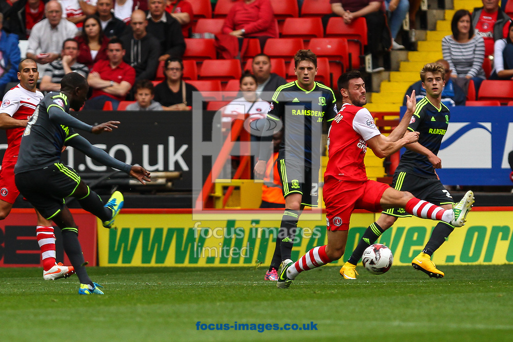 Albert Adomah of Middlesbrough (left) shoots during the Sky Bet Championship match at The Valley, London<br /> Picture by David Horn/Focus Images Ltd +44 7545 970036<br /> 27/09/2014
