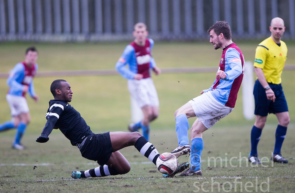 Edusport Academy Ibrahim Diallo and Whitehill Welfare John Ross Kerr. <br /> Whitehill Welfare 2 v 1 Edusport Academy, South Challenge Cup Quarter Final played 7/3/2015 at Ferguson Park, Carnethie Street, Rosewell.