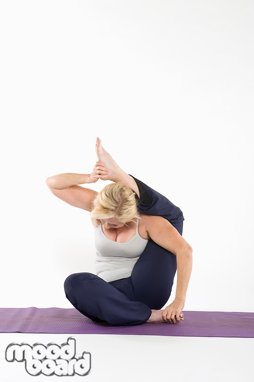Woman sitting in yoga posture