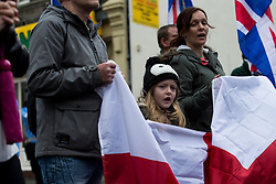 © Licensed to London News Pictures . 15/11/2014 . Kent , UK . A young girl at a march by Britain First on High Street Rochester during the final weekend before the Rochester and Strood by-election . Photo credit : Joel Goodman/LNP