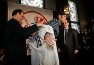 Joe Torre Manager of the New York Yankees puts on Johnny Damon  Jersey at a press confrence introducing him to the New York Media New York. Friday 23 December 2005 Andrew Gombert for the Boston Globe