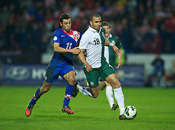 OSIJEK, CROATIA - Tuesday, October 16, 2012: Wales' Hal Robson-Kanu in action against Croatia's Darijo Srna during the Brazil 2014 FIFA World Cup Qualifying Group A match at the Stadion Gradski Vrt. (Pic by David Rawcliffe/Propaganda)