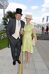 CHARLIE GORDON-WATSON and his wife KATE REARDON at the Investec Derby 2015 at Epsom Racecourse, Epsom, Surrey on 6th June 2015.