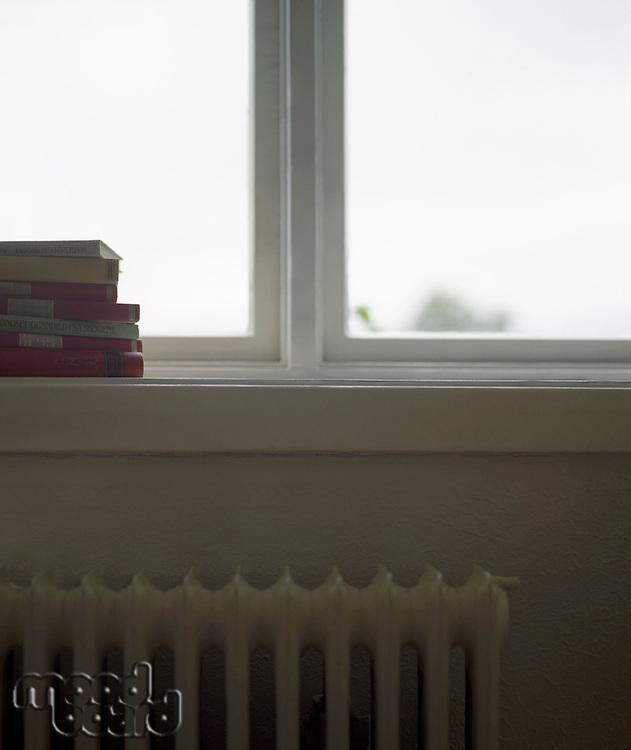 Stack of Books on Windowsill