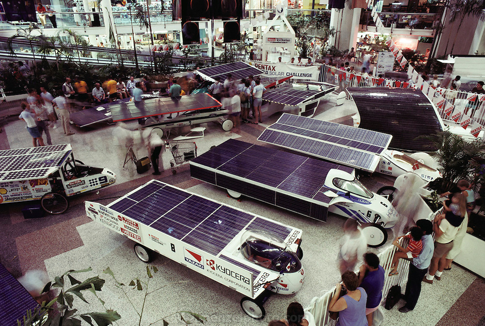 Display of solar cars that will participate in the  Pentax Solar Car Race, the first international solar-powered car race . Seen here in the Casuarina shopping mall, Darwin, Northern Territory, Australia.  (1987)