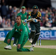 Younus Khan runs past bowler Jean-Paul Duminy during the ICC World Twenty20 Cup semi-final between South Africa and Pakistan at Trent Bridge. Photo © Graham Morris (Tel: +44(0)20 8969 4192 Email: sales@cricketpix.com)