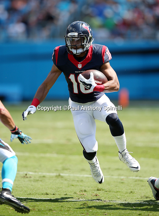 Houston Texans wide receiver Cecil Shorts III (18) runs with the ball after caching a first quarter pass during the 2015 NFL week 2 regular season football game against the Carolina Panthers on Sunday, Sept. 20, 2015 in Charlotte, N.C. The Panthers won the game 24-17. (©Paul Anthony Spinelli)