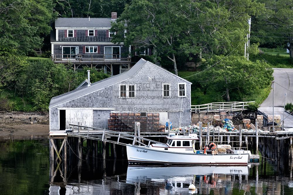 A lobster boat tied up to a lobster wharf New Harbor, Maine.   The tiny picturesque pocket harbor is one of the last working harbors on the midcoast along the Pemaquid Peninsula