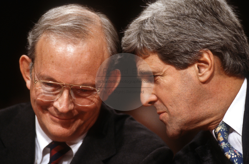National Security Advisor Anthony Lake confers with Senator John Kerry in the Senate Intelligence Committee hearing on his nomination as Director of the CIA March 11, 1997.