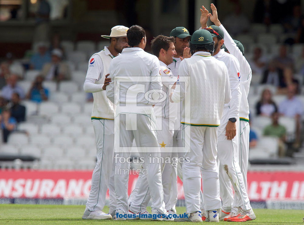 Bowler Yasir Shah of Pakistan (middle) celebrates taking the wicket of Moeen Ali of England during Day Four of the fourth Investec Test Match at the Kia Oval, London<br /> Picture by Alan Stanford/Focus Images Ltd +44 7915 056117<br /> 14/08/2016