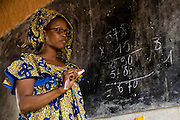 A teacher writes on the black board during class at the Kabiline I Primary school in the village of Kabiline, Senegal on Wednesday June 13, 2007.