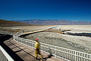 Visitors walk down a ramp into Badwater Basin in Death Valley National Park, Calif., on Oct. 26, 2012. The site, at 282 feet below sea level, is the lowest point in the U.S.