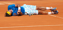 MONTE-CARLO, MONACO - Sunday, April 18, 2010: Rafael Nadal (ESP) collapses to the clay after winning the the Men's Singles Final on day seven of the ATP Masters Series Monte-Carlo at the Monte-Carlo Country Club. This was Nadal's sixth straight victory in the tournament, setting a record for the most Masters Series consecutive victories at a single tournament by any player. (Photo by David Rawcliffe/Propaganda)