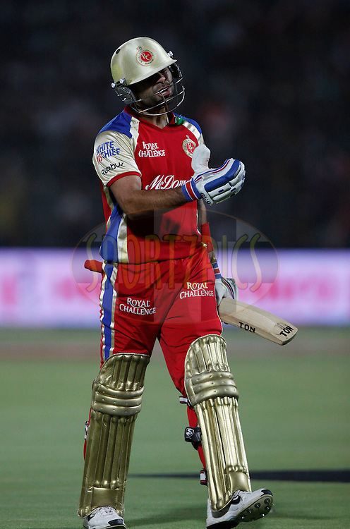 Royal Challengers Bangalore player Virat Kohli walks back after getting out during match 30 of the the Indian Premier League ( IPL) 2012  between The Rajasthan Royals and the Royal Challengers Bangalore held at the Sawai Mansingh Stadium in Jaipur on the 23rd April 2012..Photo by Pankaj Nangia/IPL/SPORTZPICS