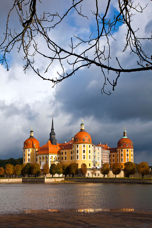"""From Wikipedia:  """"Moritzburg Castle (German: Schloss Moritzburg) is a Baroque palace in Moritzburg, in the German state of Saxony, about 13 kilometres (8.1 mi) northwest of the Saxon capital, Dresden. The castle has four round towers and lies on a symmetrical artificial island. It is named after Duke Moritz of Saxony, who had a hunting lodge built there between 1542 and 1546. The surrounding woodlands and lakes have been a favourite hunting area of the electors and kings of Saxony."""""""