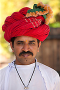 Young Indian man with traditional Rajasthani turban in Narlai village in Rajasthan, Northern India