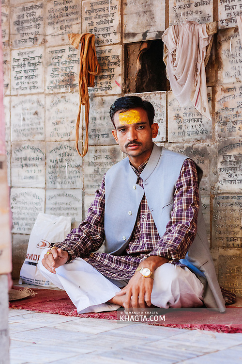 A Pandit sittion in a temple chanting hindu text in Vishram Ghat. Mathura is a sacred town situated on the banks of Yahuman river in Uttar Pradesh, northern India. The birthplace of the deity Lord Krishna. It is a pilgrimage site for Hindus.