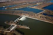 Nederland, Limburg, Gemeente Maasgouw, 07-03-2010; onder in beeld de Stuw van Linne, met waterkrachtcentrale naast de stuw (linkonder). Midden rechts Overlaat van Linne (l) met een oude Maasarm, op het tweede plan .het sluiscomplex van Heel. Geheel boven de sluis voor het Lateraalkanaal, de kleinere sluis (verscholen achter de bomen) geeft toegang tot de Maas naar Roermond..Below Linne Weir, with hydroelectric plant (l). Middle right Linne Spillway (l) with an old branch of river Meuse. Very top: entrance to locks of Lateral canal, the smaller lock (behind the trees) is to river Meuse..luchtfoto (toeslag), aerial photo (additional fee required);.foto/photo Siebe Swart