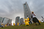 Pikachu statues in small park in front of Landmark Tower during the third annual Pikachu Outbreak event in Yokohama, Kanagawa, Japan. Saturday August 13th 2016. The event is hosted by the Pokemon Company. Over 1,000 Pikachu characters are set to appear in week of events from 7th to 14th of August..