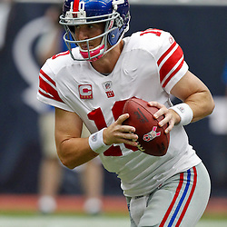 October 10, 2010; Houston, TX USA; New York Giants quarterback Eli Manning (10) against the Houston Texans during the second half at Reliant Stadium. The Giants defeated the Texans 34-10. Mandatory Credit: Derick E. Hingle