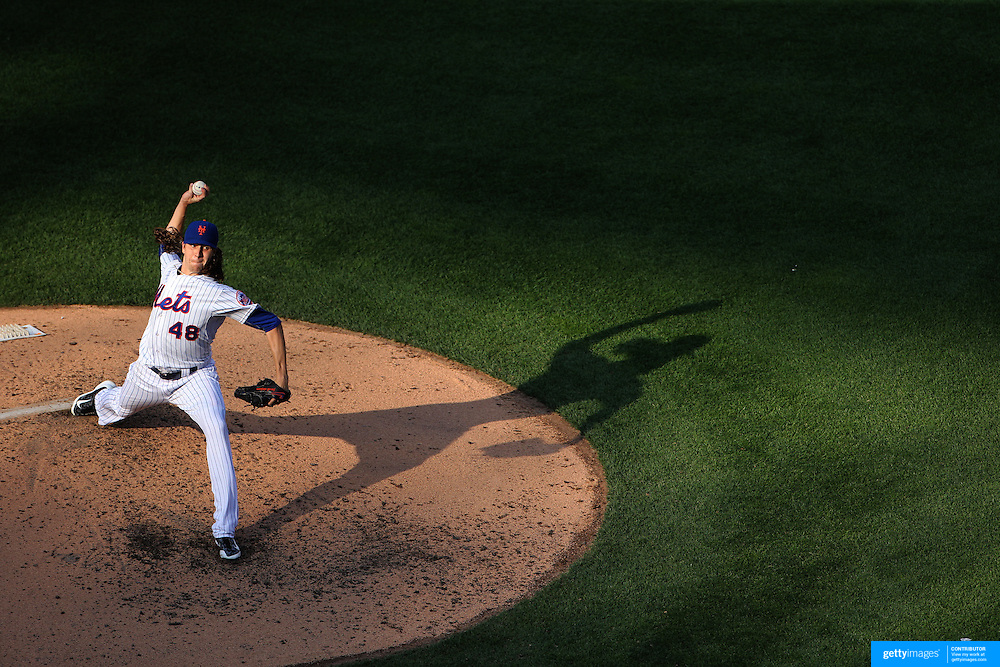 Jacob deGrom, New York Mets, pitching in the late afternoon sunlight during the New York Mets Vs Boston Red Sox MLB regular season baseball game at Citi Field, Queens, New York. USA. 29th August 2015. Photo Tim Clayton