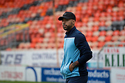 30th August 2019; Dens Park, Dundee, Scotland; Scottish Championship, Dundee Football Club versus Dundee United; Kane Hemmings of Dundee inspects the pitch before the match