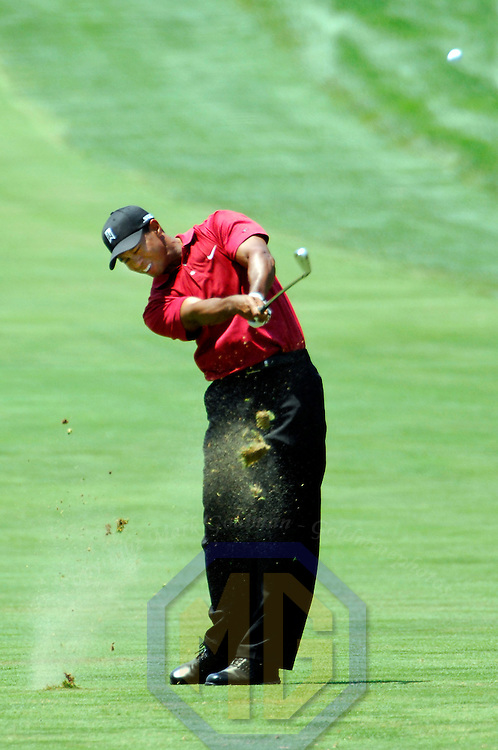 08 July 2007:  Tiger Woods hits his second shot on the 3rd hole in the final round of the inaugural AT&T National PGA event at Congressional Country Club in Bethesda, Md.  Woods finished in a tie for 6th place with a 2 under par score of 278.   K. J. Choi won the tournament with a 9 under par score of 271.  ****For Editorial Use Only****